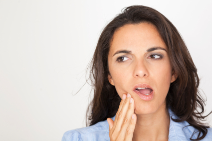 Woman in need of gum disease treatment in Chandler, AZ.